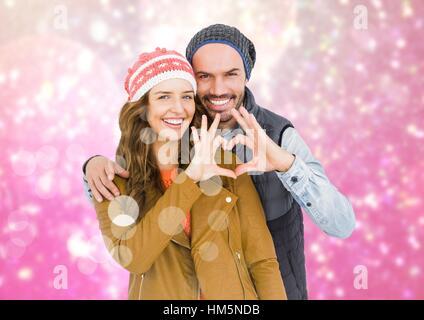 Forme de coeur formant Couple avec les mains contre l'arrière-plan création numérique Banque D'Images