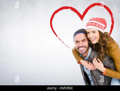 ... Portrait of happy man giving piggy back to woman against white  background Banque D Images 6f613f1bd1a