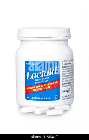 Comprimés Lactaid, bouteille de l'enzyme lactase Comprimés pour l'intolérance au lactose Banque D'Images