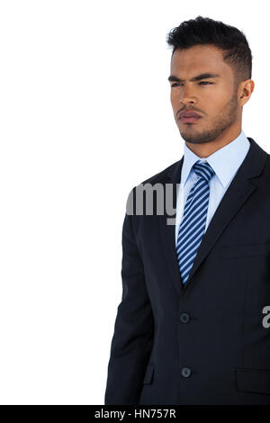 Thoughtful businessman standing against white background Banque D'Images
