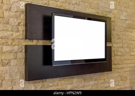 Écran de télévision sur le nouveau mur arrière-plan. Salon moderne - intérieur plat sur mur de brique Banque D'Images