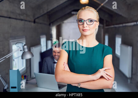 Confident female manager standing in modern office Banque D'Images