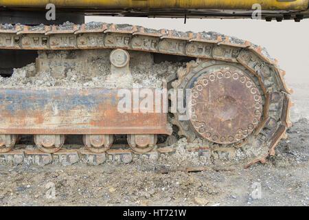 Crawler boueux dans des détails de la chaîne d'ambiance Banque D'Images