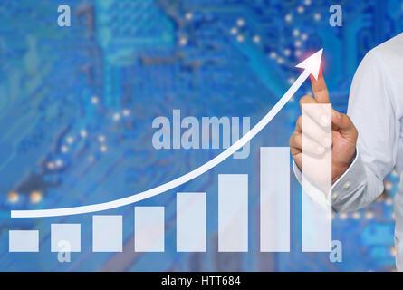 Businessman de toucher dans le pic d'activité graphique sur fond flou abstrait du Concept électronique,symboles Banque D'Images