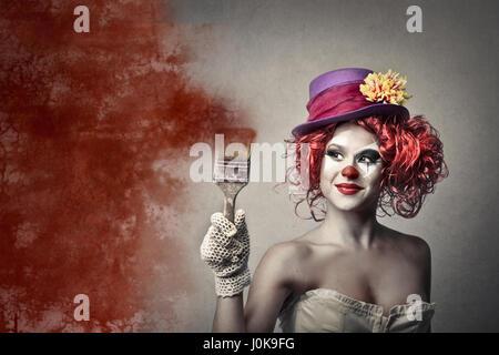Femme clown avec le pinceau Banque D'Images