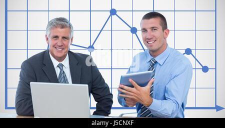 Digital composite de Businessmen smiling lors de l'utilisation de technologies avec graphique Banque D'Images