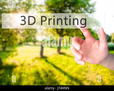 L'impression 3D - part en appuyant sur un bouton sur l'arrière-plan flou concept . Le commerce, la technologie, Banque D'Images