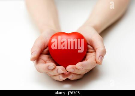 Soins cardiaques, de l'assurance-santé ou de donner de l'amour concept Banque D'Images