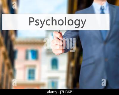 Psychologie - Business man showing signe. Le commerce, la technologie, internet concept. Stock Photo Banque D'Images