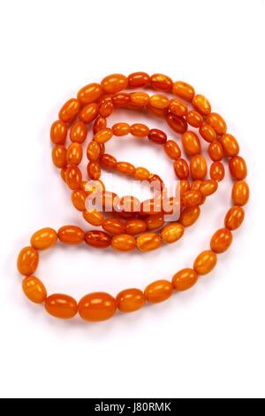 Un brin de perles d'ambre au caramel. Banque D'Images