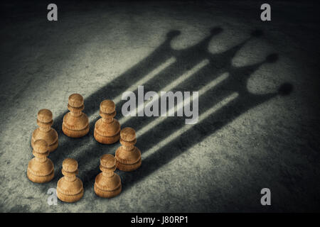 Se tenant ensemble de pions, disposées en cercle se joindre au pouvoir, jette une ombre en forme de couronne. Groupe d'affaires Leadership et travail d'équipe concep