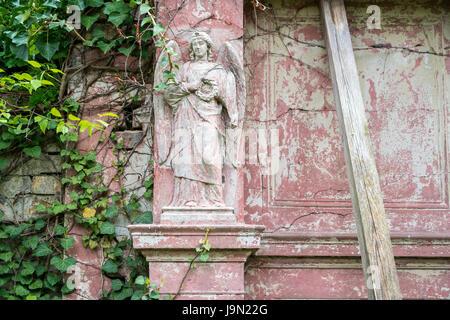 Vieux grungy relief d'un ange Banque D'Images