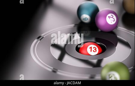 Concept de jeu, chance et numéro treize. Une balle avec le nombre 13 à l'intérieur d'un trou avec d'autres balles Banque D'Images