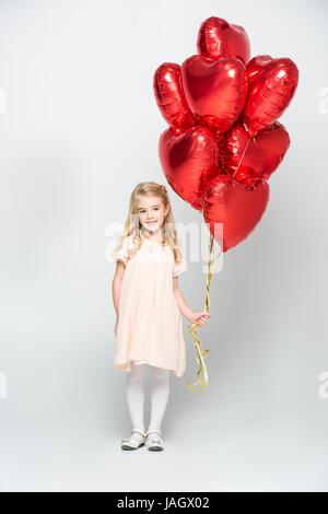 Fille avec des ballons d'air Banque D'Images
