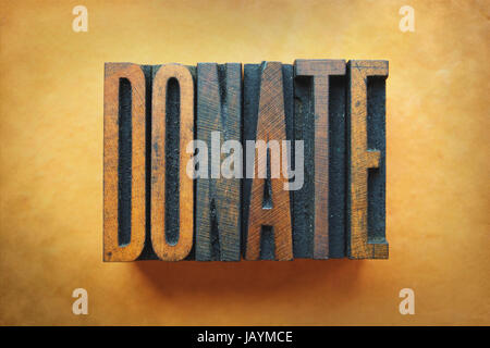 Faire un don Le mot écrit en typographie vintage type. Banque D'Images