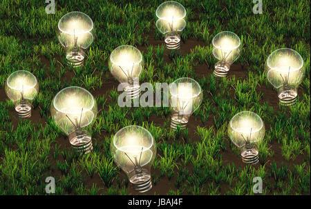 Certaines ampoules allumées de différentes tailles, sont de plus en plus que des idées sur un sol herbeux comme Banque D'Images
