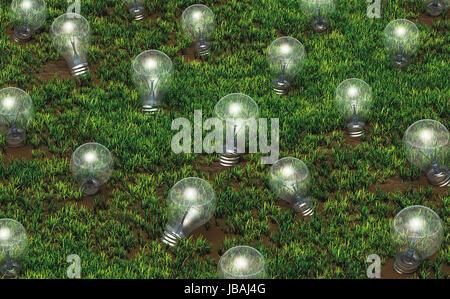 Certaines ampoules non éclairé de différentes tailles, sont de plus en plus que des idées sur un sol herbeux comme Banque D'Images