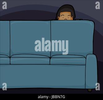 Peur de jeter l'enfant asiatique derrière canapé Banque D'Images