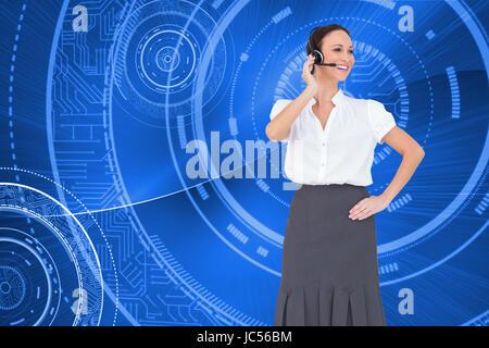 Composite image smart call centre agent travaillant tout en se posant Banque D'Images