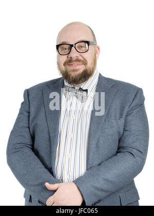 Homme barbu souriant dans une veste. Banque D'Images