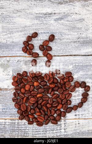 La vapeur à partir de grains de café, tasse. Banque D'Images