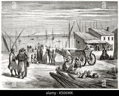 Ancien port vue du sol à l'horizon de la mer. Les commerçants, les chariots avec des boeufs, des marchandises et Banque D'Images