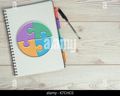 Bloc-notes avec stylo,puzzle graphique sur planche de bois Banque D'Images