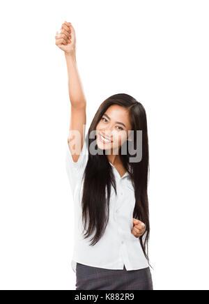 Jeune femme asiatique se réjouit de son succès ou de victoire. Femme d'occasionnels gagner avec acclamations jusqu'à Banque D'Images