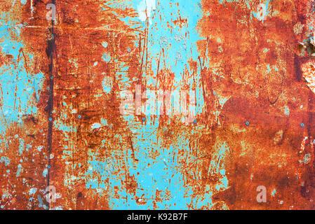 Tons orange et bleu sarcelle grunge corrodés rusty metal plate surface texture en arrière-plan Banque D'Images
