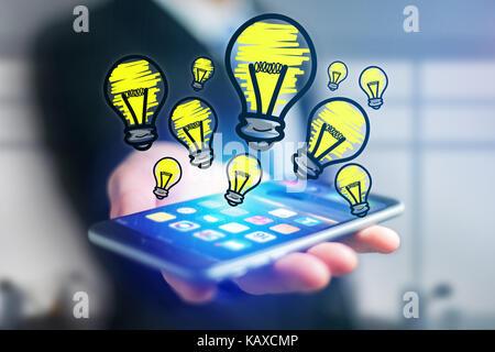 Vue de l'icône de la main d'ampoule de sortir un smartphone interface d'un homme d'affaires au bureau - concept d'idées