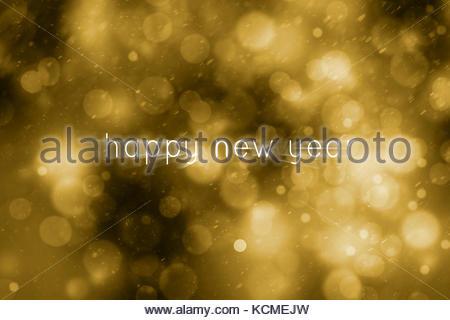 Résumé de la création d'or magique motion blurred bonne année écrit sur l'arrière-plan flou flou d'obscurité. Belle Banque D'Images