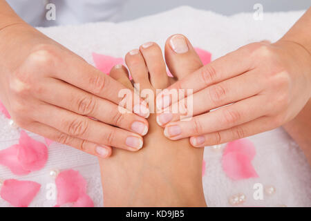 Close-up of woman's feet recevant pied massage in spa