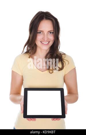 Portrait of smiling woman holding digital tablet over white background Banque D'Images