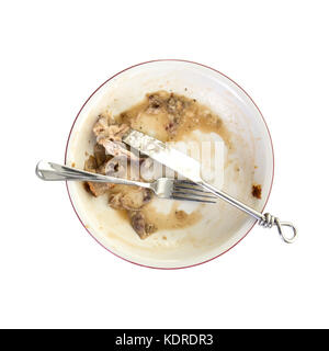 Une plaque vide, sale après le repas est terminé. vue aérienne sur un fond blanc Banque D'Images