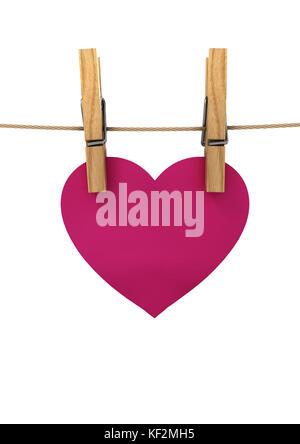 Coeur rose accroché sur une chaîne pinces à linge épinglé, un concert pour la Saint-Valentin Banque D'Images