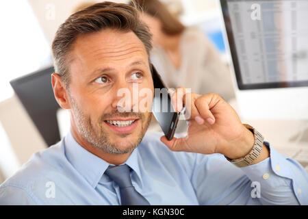 Portrait of businessman talking on mobile phone