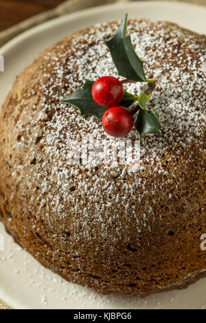 Figgy pudding de Noël maison sucrée avec du sucre en poudre