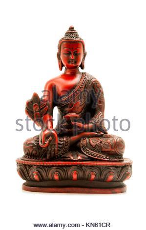 Bhaisajyaguru (le Bouddha de la guérison et de la médecine) sur un fond blanc. Banque D'Images