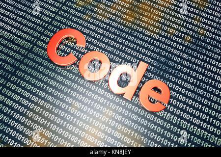 Le mot code devant un arrière-plan binaire. Banque D'Images