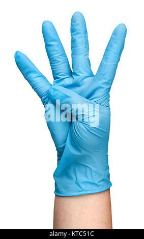 Gants en latex bleu à la main montrant quatre doigts Banque D'Images