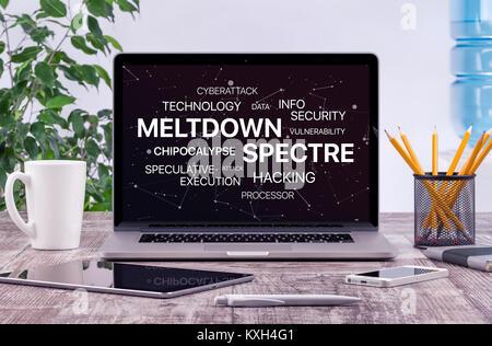 Meltdown et spectre menace sur l'écran du portable au concept de travail de bureau. Banque D'Images