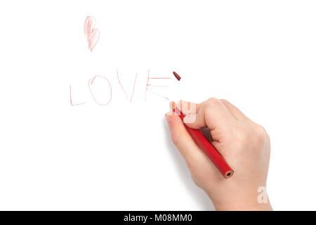 La main de l'enfant écrit le mot amour et a cassé la tête sur la dernière lettre, isolé sur fond blanc Banque D'Images