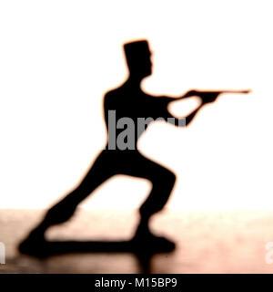 Figurine soldat un fusil de tir Banque D'Images