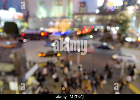 Image abstrait floue des piétons au croisement de Shibuya à Tokyo, Japon. Banque D'Images