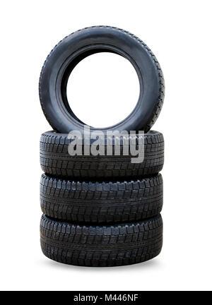 Pile de quatre roues pneus d'hiver pour voiture noir Banque D'Images