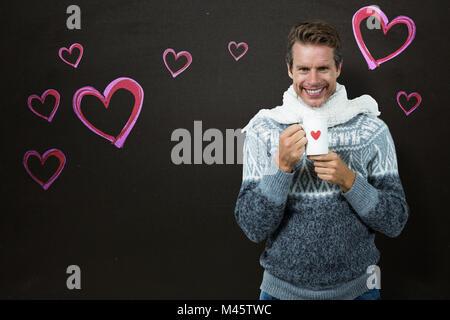Composite image of happy man holding mug Banque D'Images
