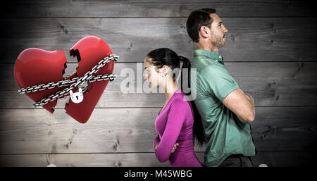 Image composite du couple standing back to back Banque D'Images