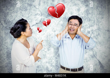 Image composite de l'older asian couple having an argument Banque D'Images