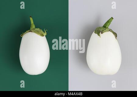 Aubergines blanches isolé sur fond gris et vert Banque D'Images