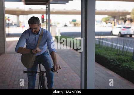 Man looking at smartwatch